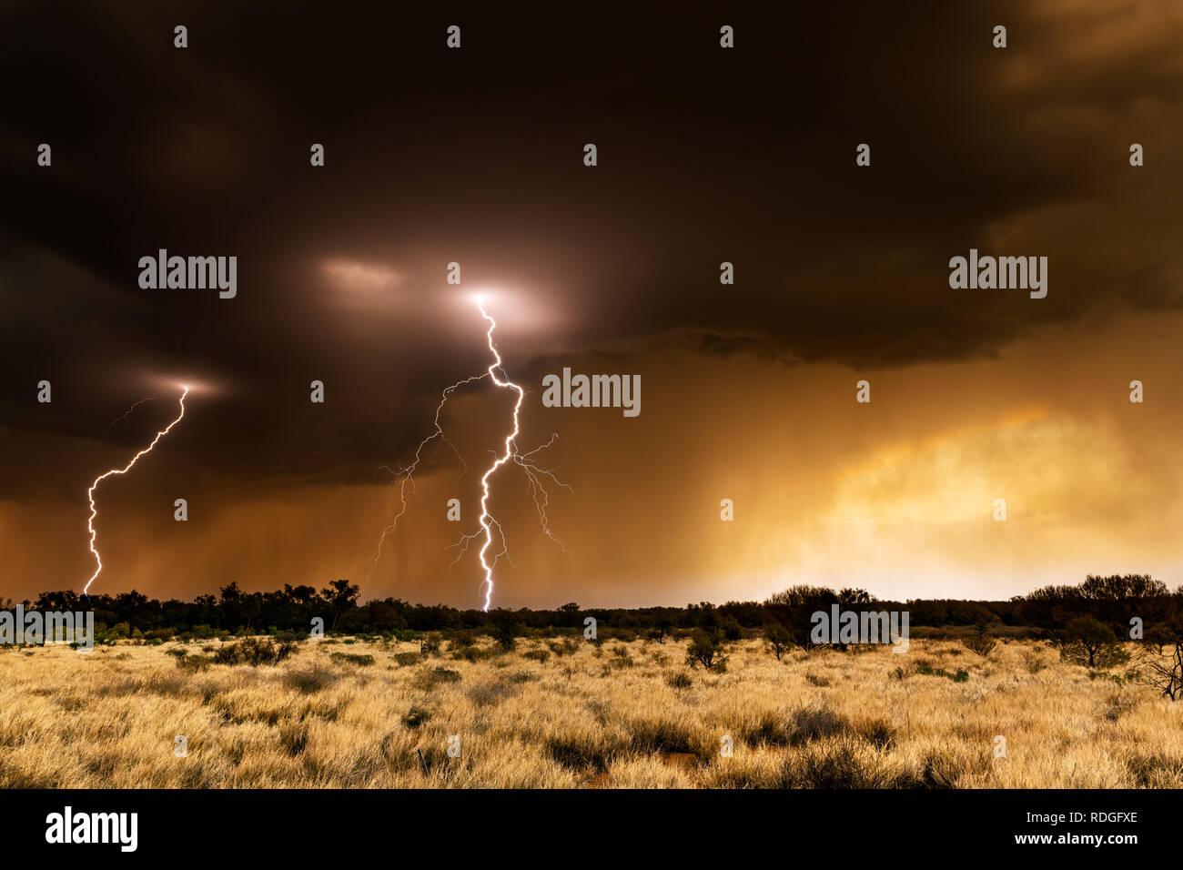 Thunderstorm and lightning in the australian desert. - Stock Image
