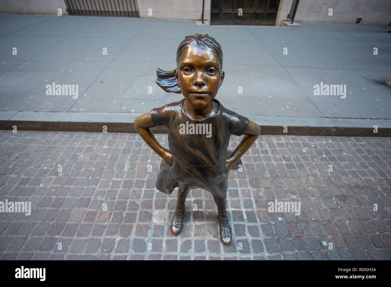 Fearless girl statue in front of the New York Stock Exchange, Wall Street, Manhattan, New York, USA - Stock Image