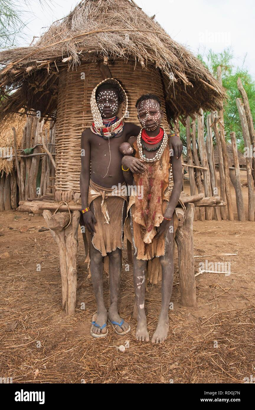 Two Karo girls with necklaces made of cowry shells and facial paintings, Omo river valley, Southern Ethiopia, Africa - Stock Image