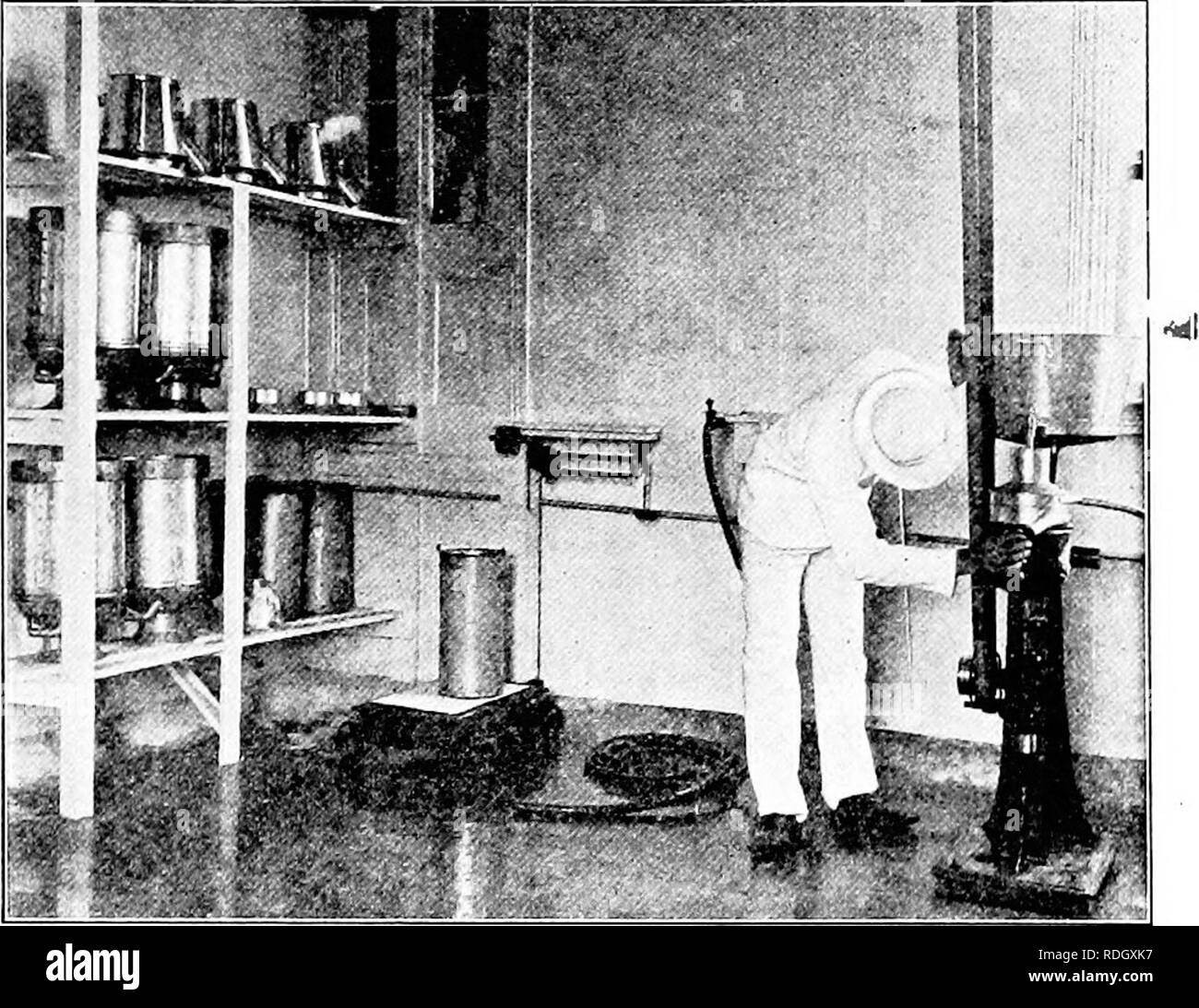 . Dairy laboratory guide. Dairying. CREAM SEPARATORS. Fig. 5. — Dairy-room, Maryland Agricultural Experiment Station, Dairy Building; showing correct method of draining pails and cans; properly rounded cement cor- ners of room; and student regulating the flow of oil into the upper bearing of cream separator. parts touch; they will thus areate and dry without rusting. Repeat, using each separator, and note difference in construction.. Please note that these images are extracted from scanned page images that may have been digitally enhanced for readability - coloration and appearance of these il - Stock Image