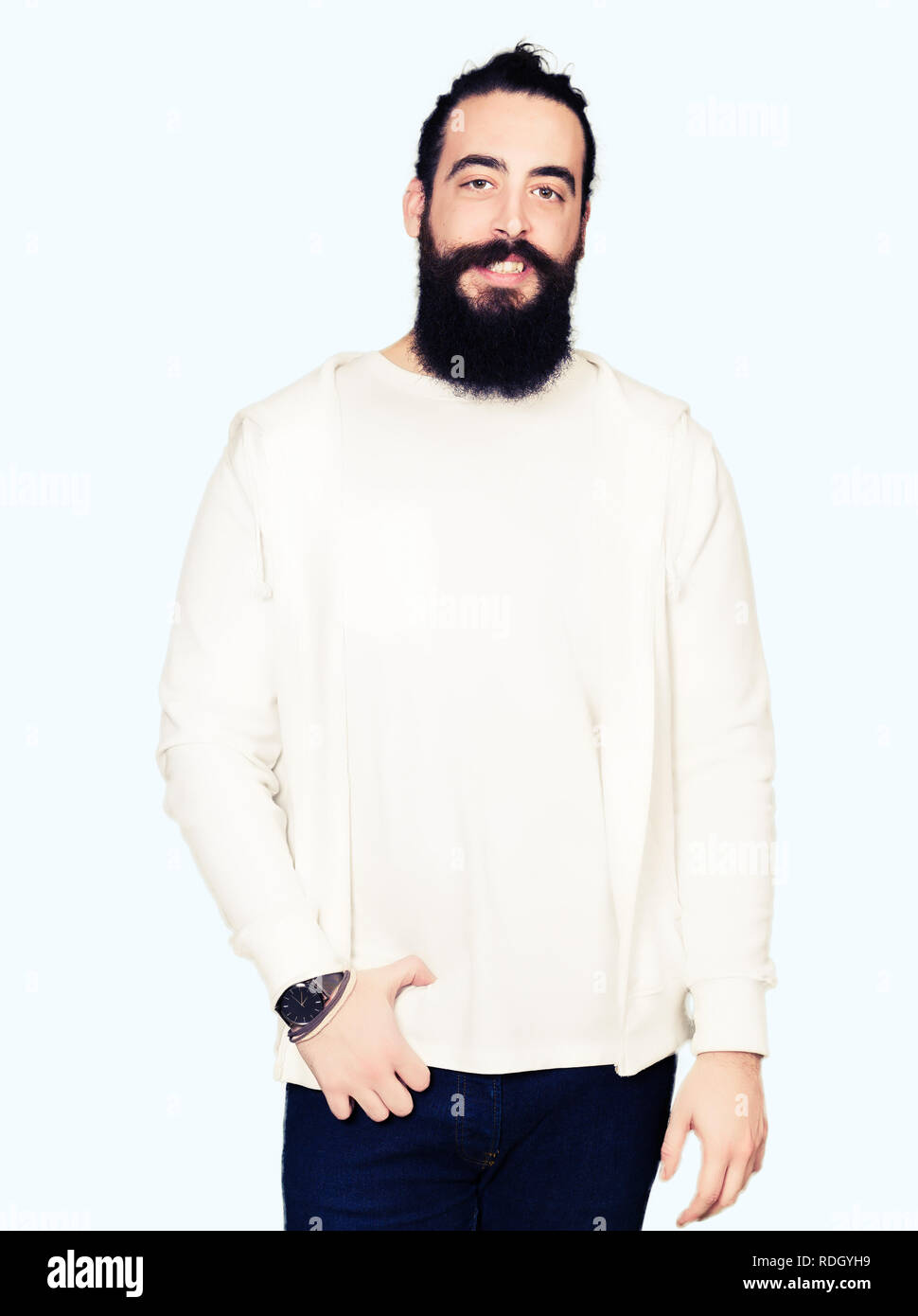 Young Hipster Man With Long Hair And Beard Wearing Sporty