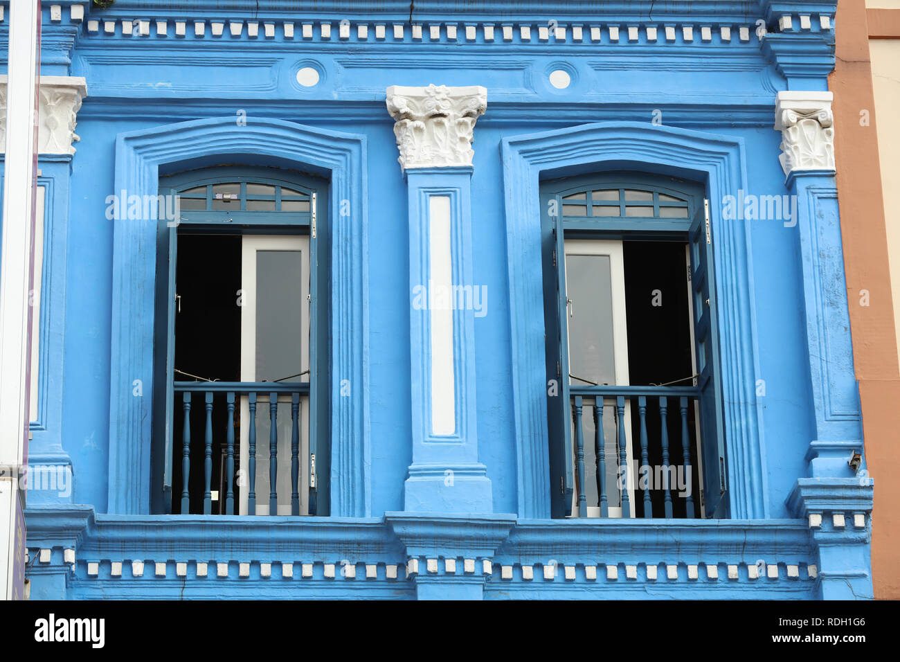 Colourful blue painted house in Chinatown Singapore, one of the many older style traditional buildings in the city, attracting tourists and visitors. Stock Photo