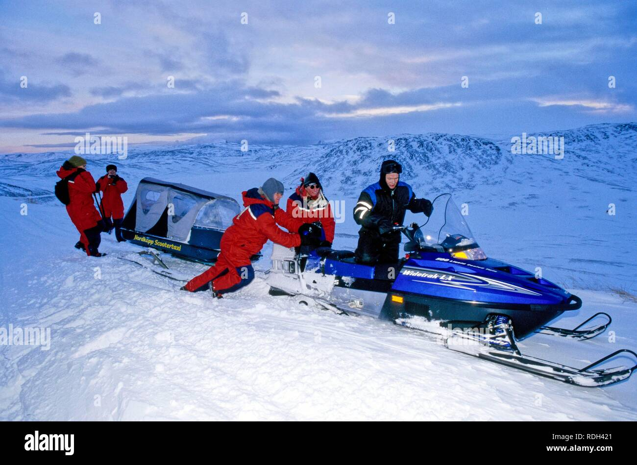 A snowmobile has stalled at the North Cape and is set afloat again, Norway, Europe - Stock Image