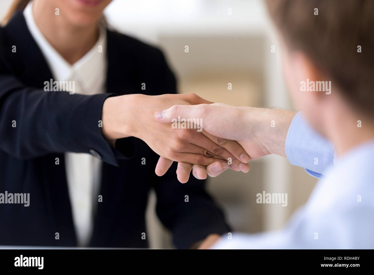 Close up man and woman shaking hands, getting acquaintance, agre - Stock Image