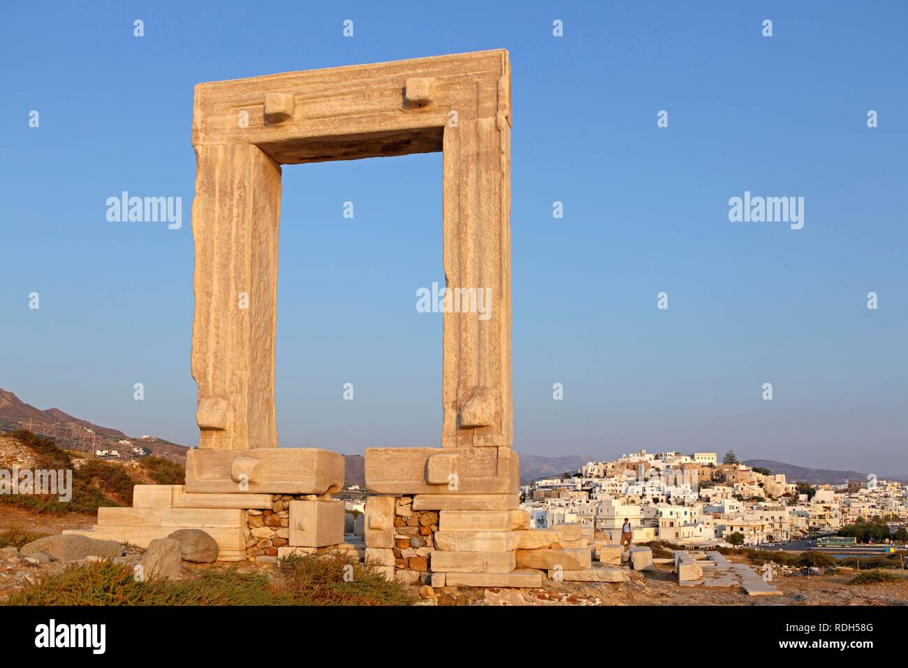 Portara or gate of the Temple of Apollo, Naxos town, Naxos island, Cyclades, Aegean Sea, Greece, Europe - Stock Image