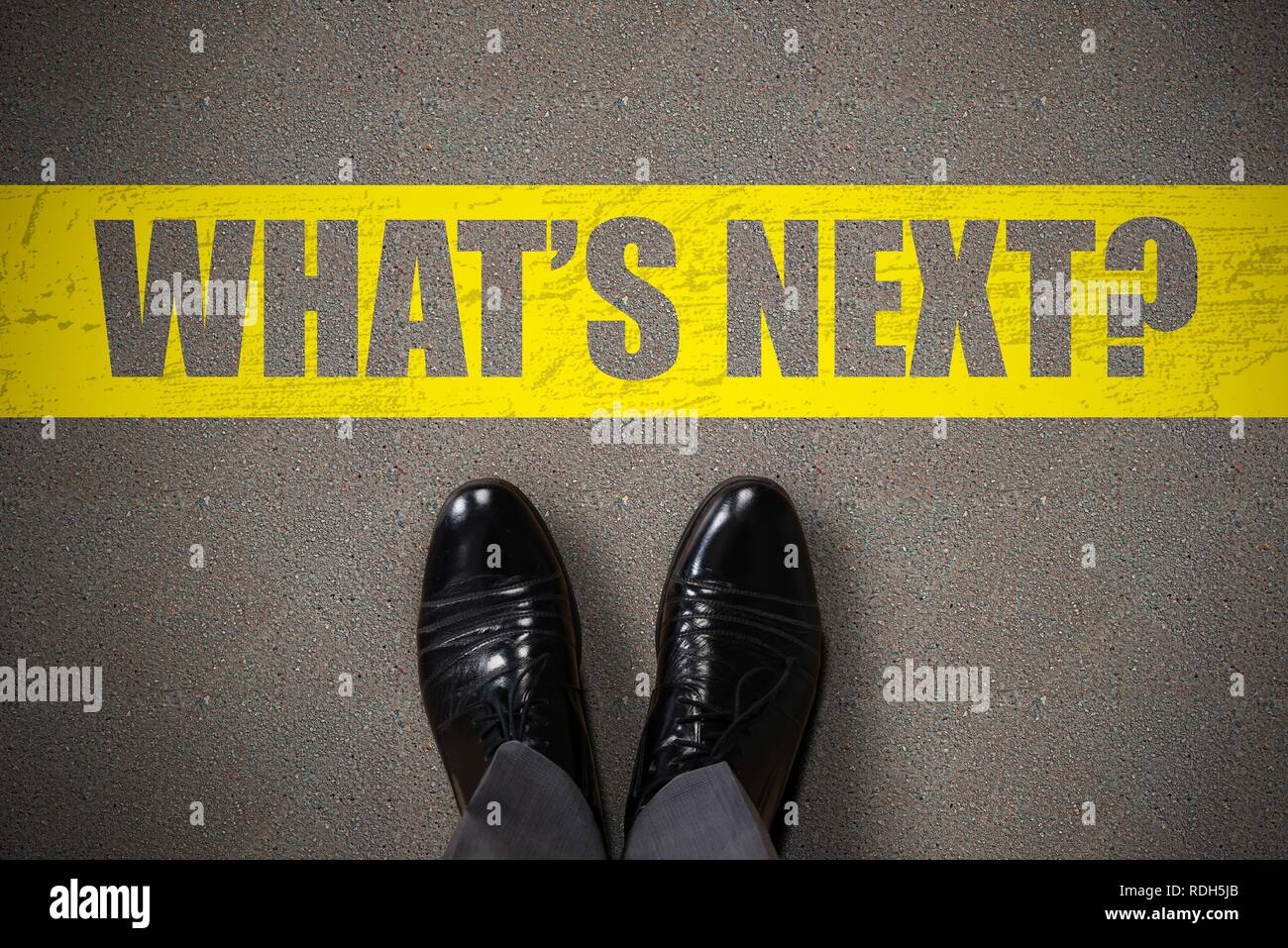 Person's Standing Next To What's Next Text On Asphalt Background - Stock Image