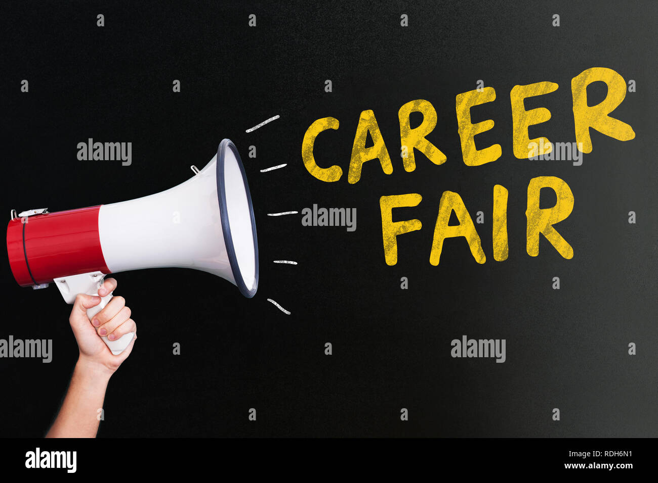 A Person's Hand Holding Megaphone Near Yellow Career Fair Text On Black Backdrop - Stock Image