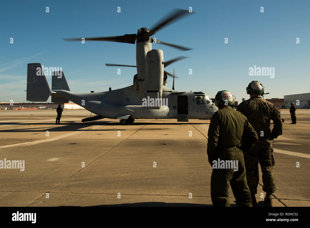 NAVAL STATION NORFOLK, NORFOLK, Va. —Marines with Marine Medium Tiltrotor Squadron 774 oversee the functions check of an MV-22 Osprey before a familiarization flight Jan. 16, 2018, at Naval Station Norfolk in Norfolk, Virginia. The flight afforded U.S. Marine Forces Command Marines and Sailors the opportunity to experience what it is like to fly in an osprey and strengthen unit morale between VMM-774 and MARFORCOM. (U.S. Marine Corps photo by Cpl. Danielle Prentice/ Released) Stock Photo