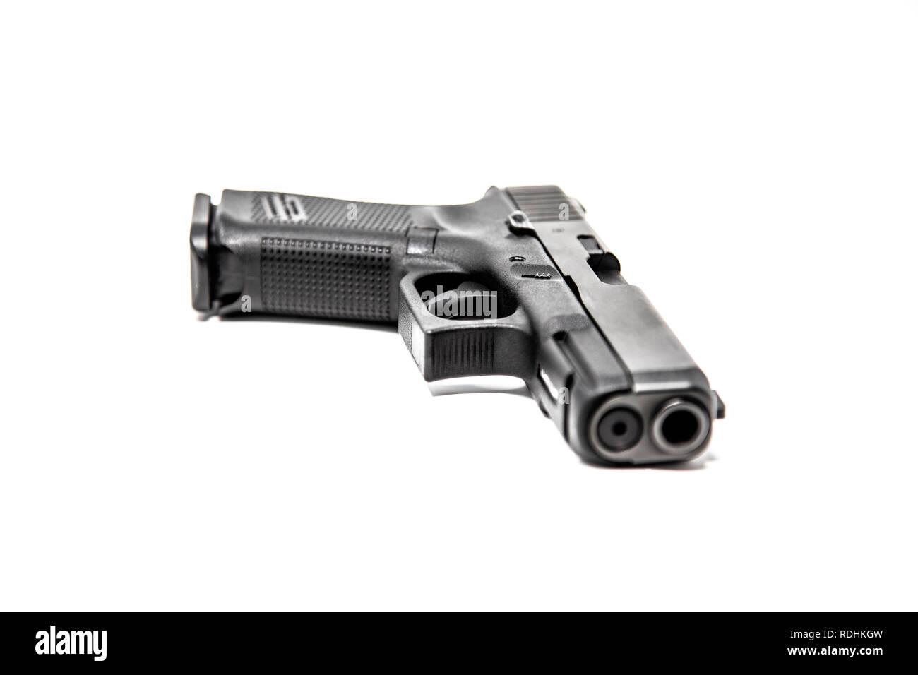 Black Semi-Automatic Handgun on White Background - Stock Image