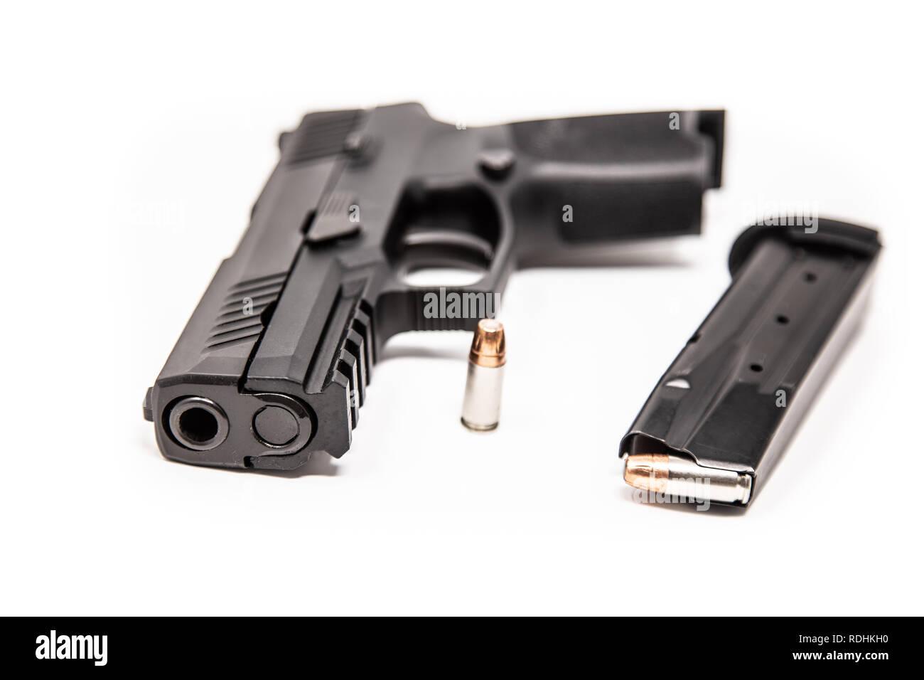 Black Semi-Automatic Handgun & Bullet w/ Magazine - High Key on White Background - Stock Image