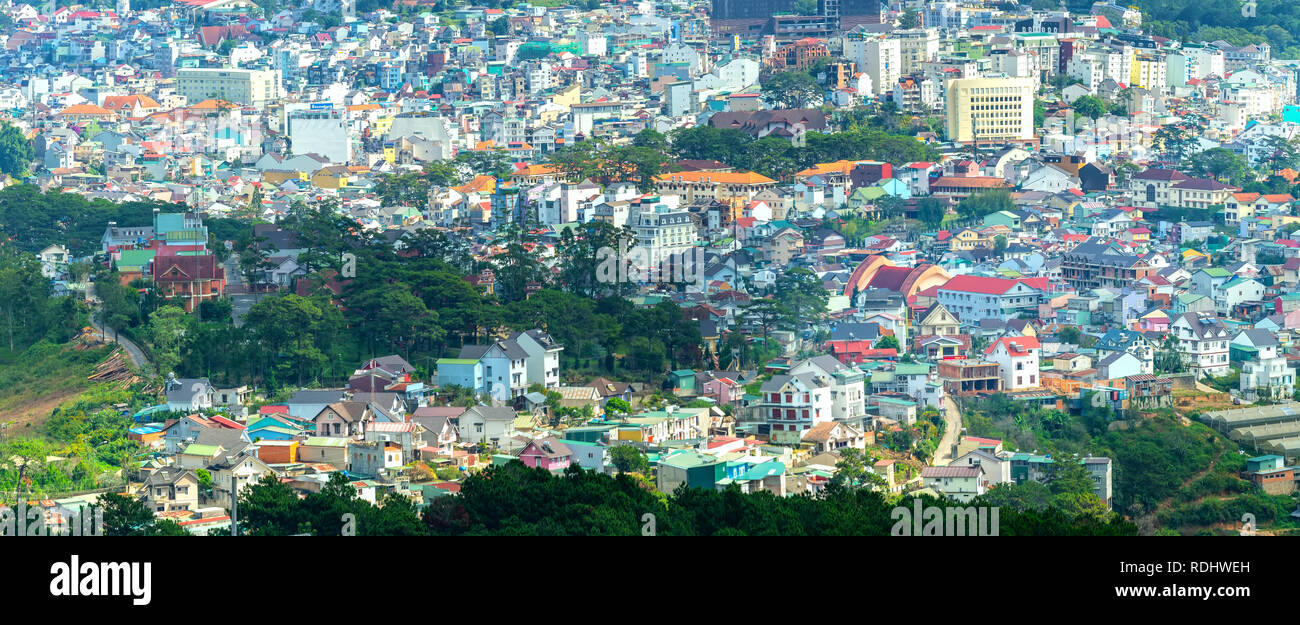 The panorama of Da Lat city is seen from above with the intertwined house architecture Stock Photo