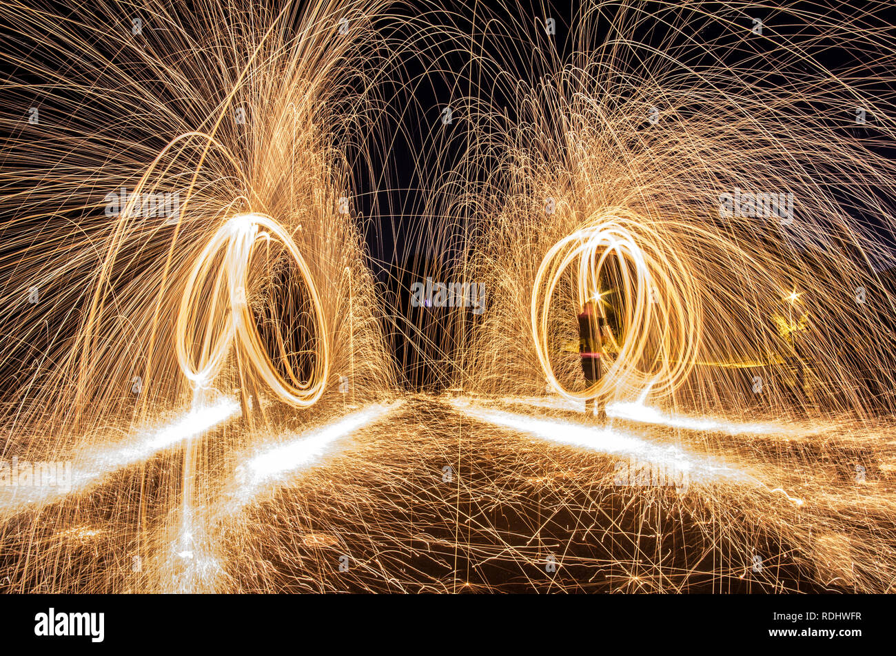 Steel wool photograph at night, long exposure photography workshop Stock Photo