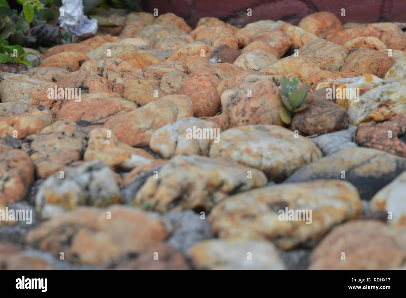 Brown / bronze stones and rocks on the ground - Stock Image