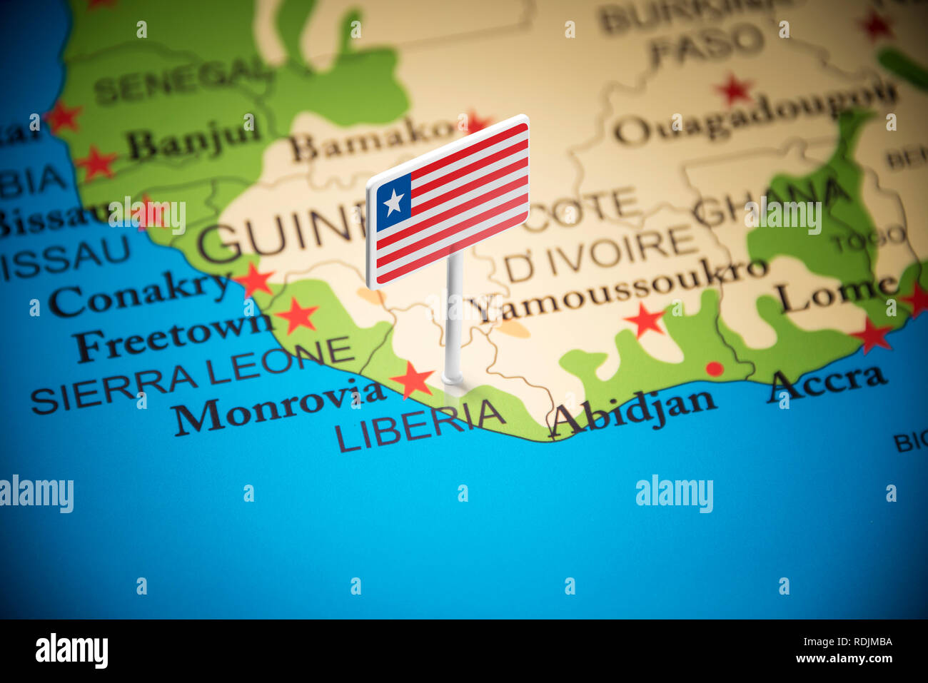 Liberia marked with a flag on the map Stock Photo
