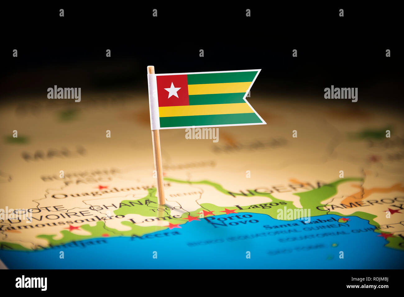 togo marked with a flag on the map - Stock Image