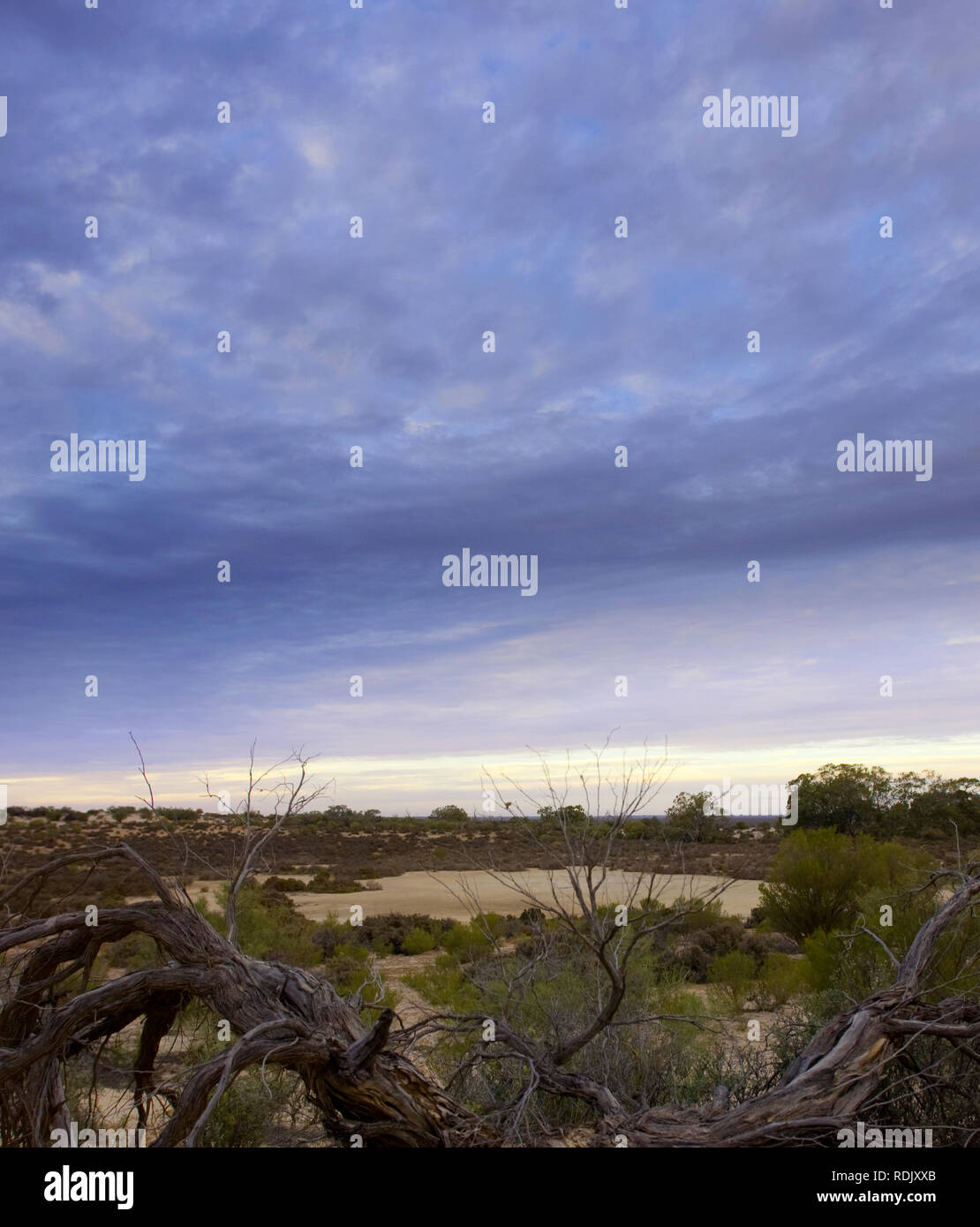 Storm clouds over a dry Emu Lake, Menindee Lakes, New South Wales, Australia - Stock Image