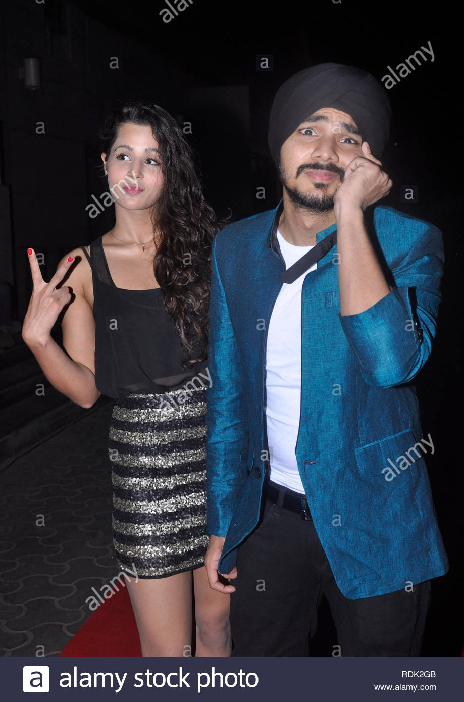 Gurdeep Singh Mehndi, son of popular Indian Bhangra pop singer Daler Mehndi and Newzealand base actress Radhika Vaid pose during the premiere of his debut film 'Meri Shadi Karao' in Mumbai, India on January 03, 2013. (Deven Lad/SOLARIS IMAGES) - Stock Image