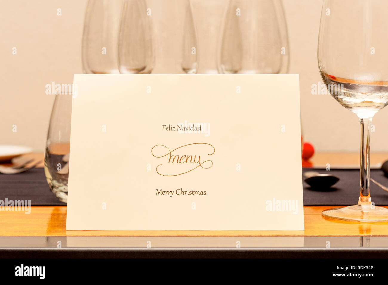 Christmas Menu laid on the table before dinner. - Stock Image