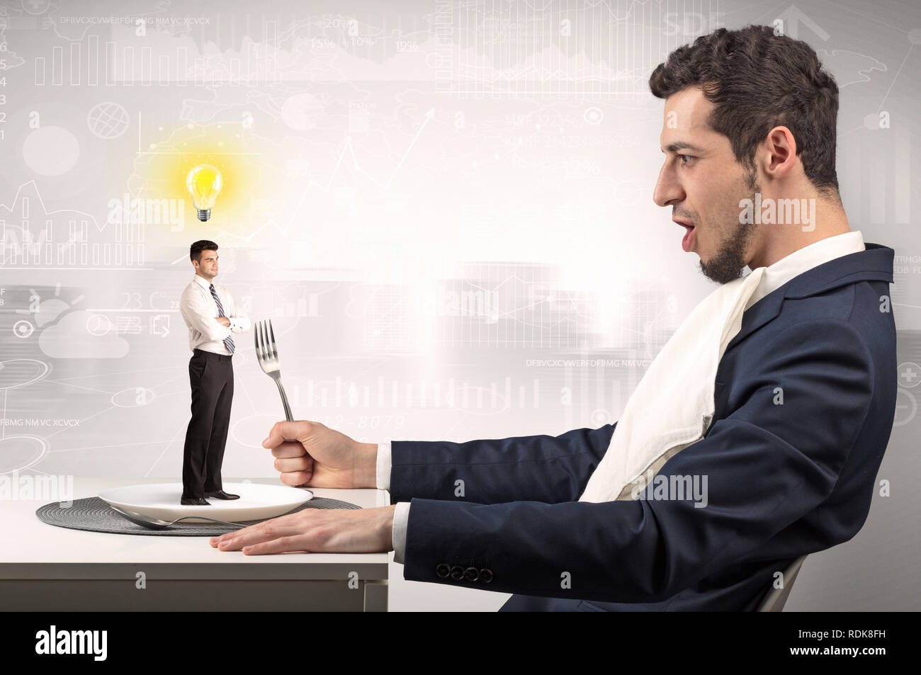 Giant businessman eating small man with financial background  - Stock Image