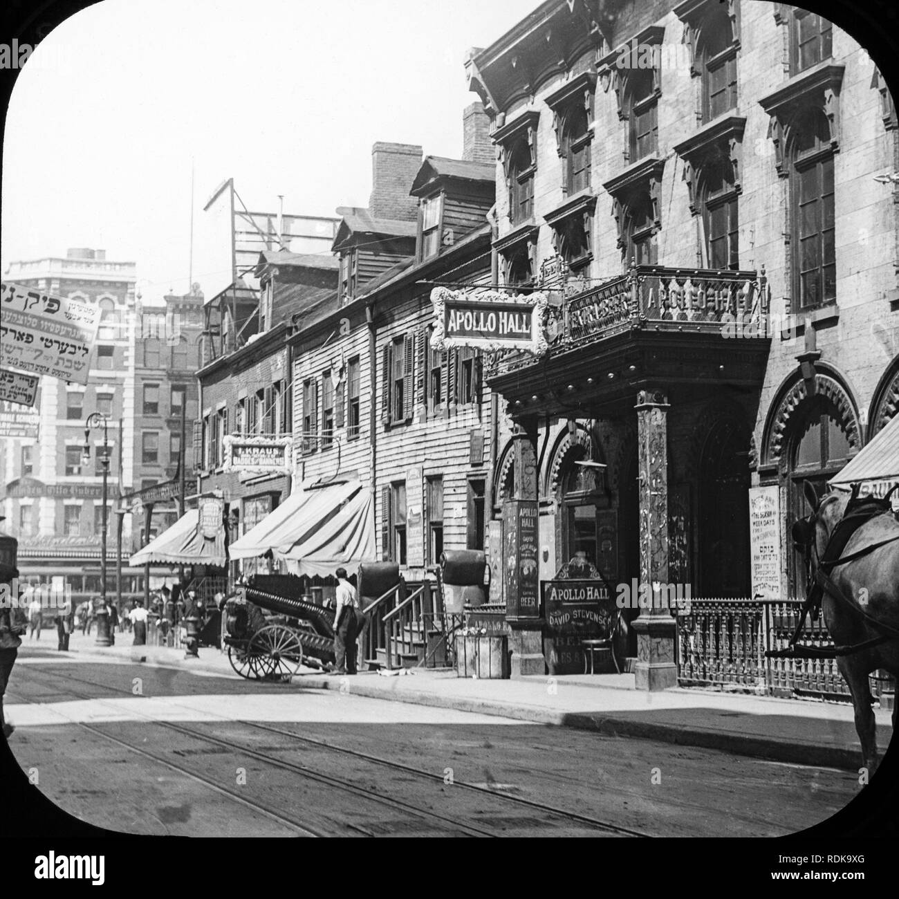 Late Victorian view of Clinton Street in the Jewish Quarter in New York City. The Apollo Hall Theatre on the right. - Stock Image
