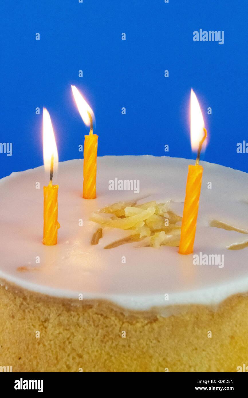 Single Blue Background with Yellow Cake - Stock Image