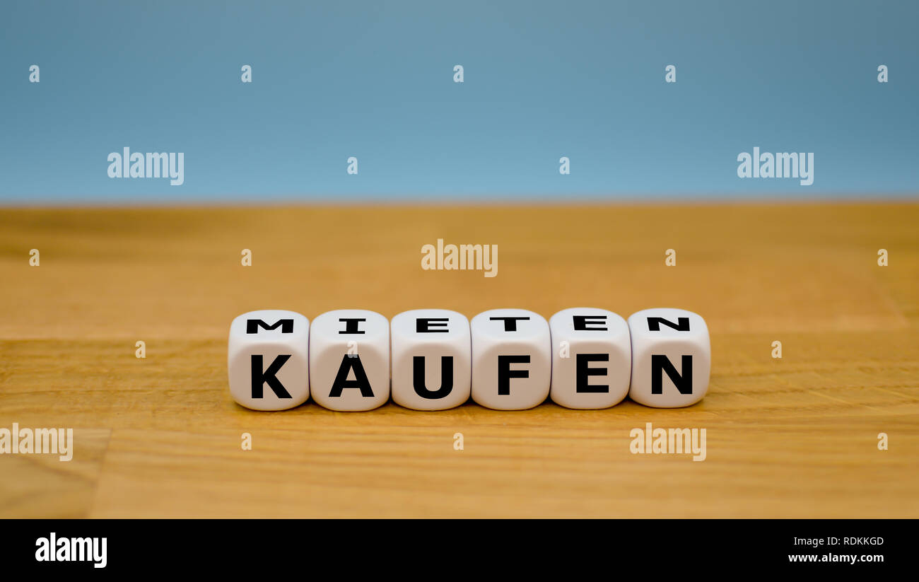 Rent or buy? Dice form the words 'kaufen' or 'mieten' (German for 'buy' or 'rent') - Stock Image