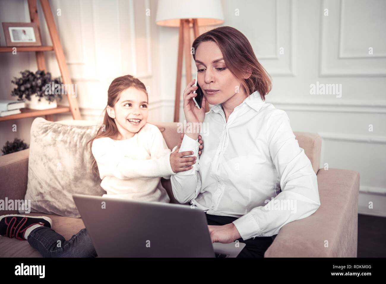 Serious professional businesswoman talking on the phone - Stock Image