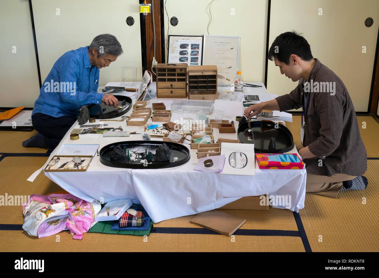 Kumamoto, Japan - November 11, 2018: Artists are creating Bonseki, tray rocks, an ancient Japanese art of miniature landscapes - Stock Image