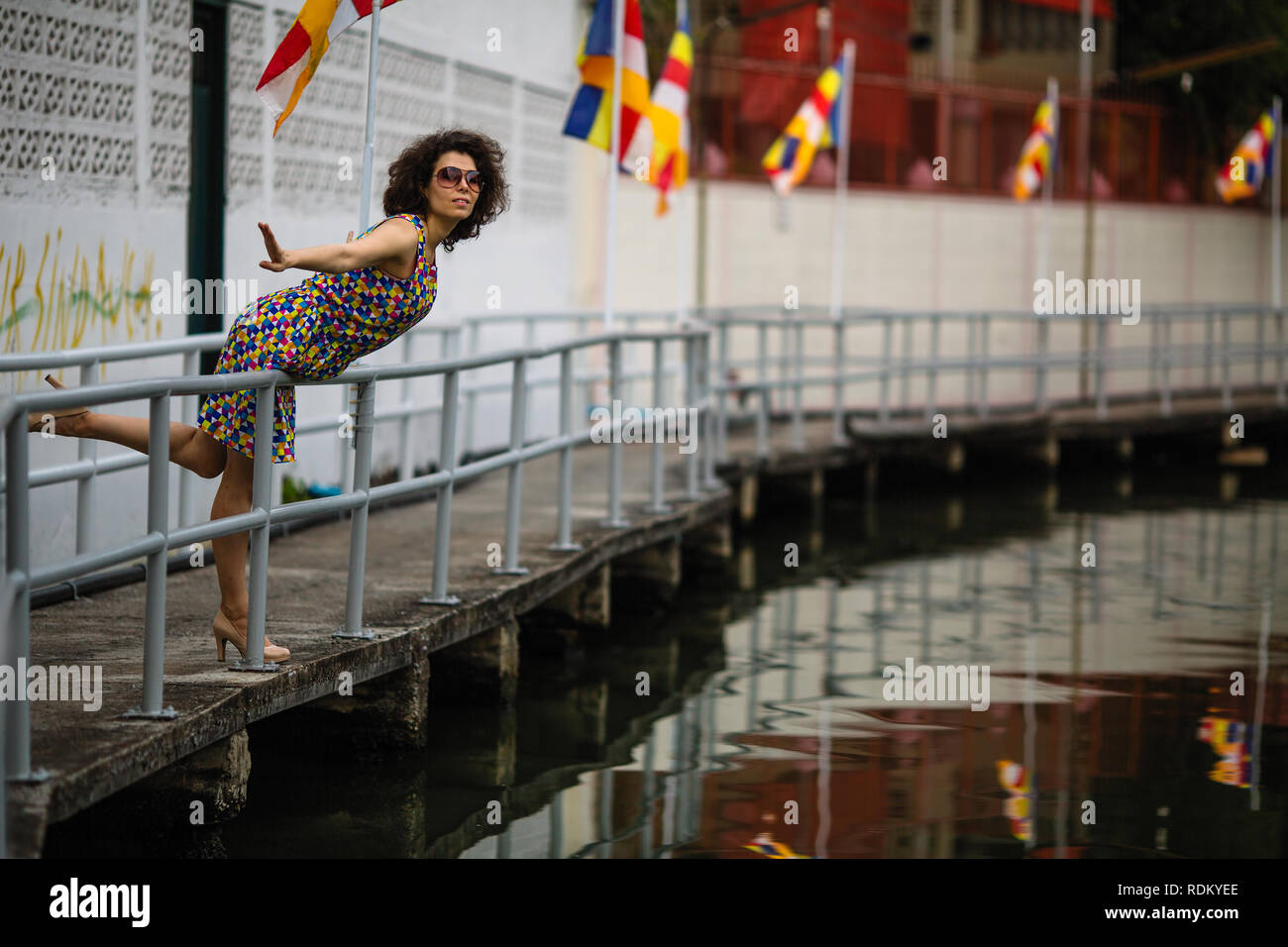 Asian woman wearing sunglasses on the river embankment. Stock Photo