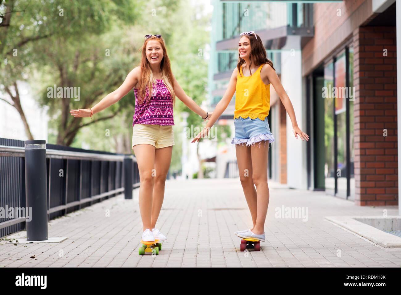 08dfad80 teenage girls riding skateboards in city Stock Photo: 232165379 - Alamy