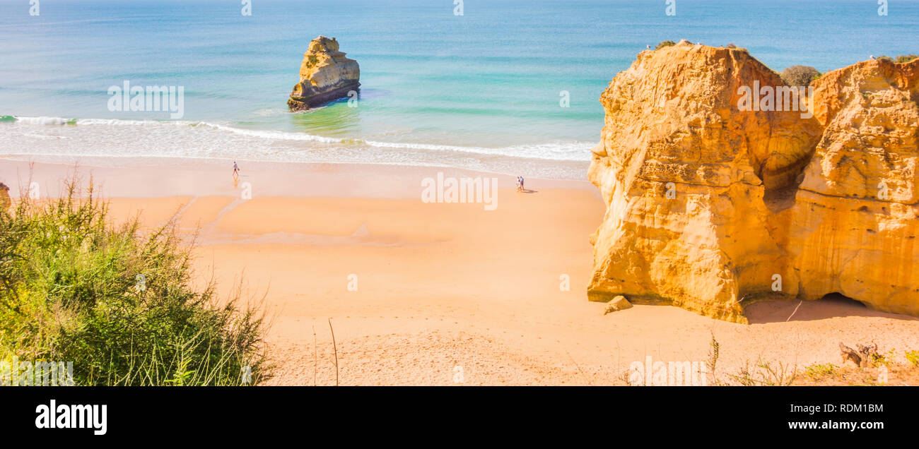 tourists on empty algarve beach in early season Stock Photo