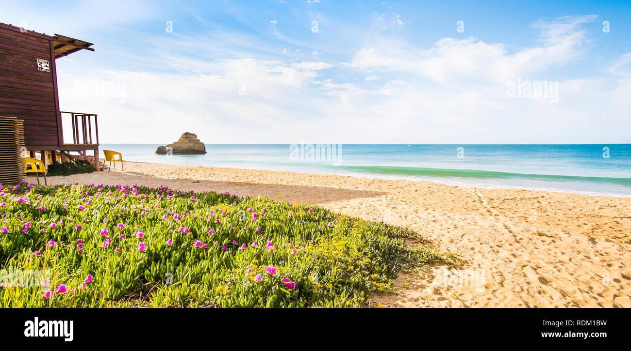 wooden beach hut on deserted beach - Stock Image