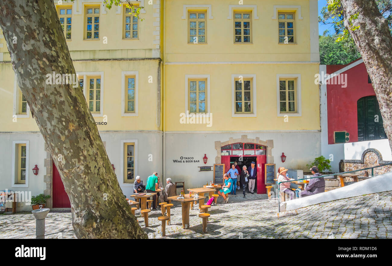 tourists and spa guests in front of o tasco, wine & beer bar, serra de monchique Stock Photo