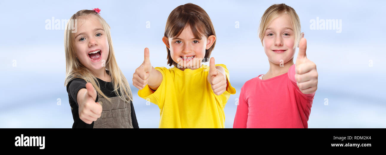 Group of children kids smiling young little girls success thumbs up positive banner young - Stock Image