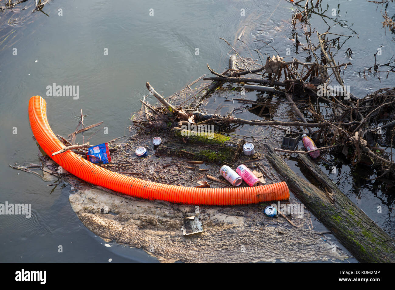 Rubbish dumped in a river, uk - Stock Image