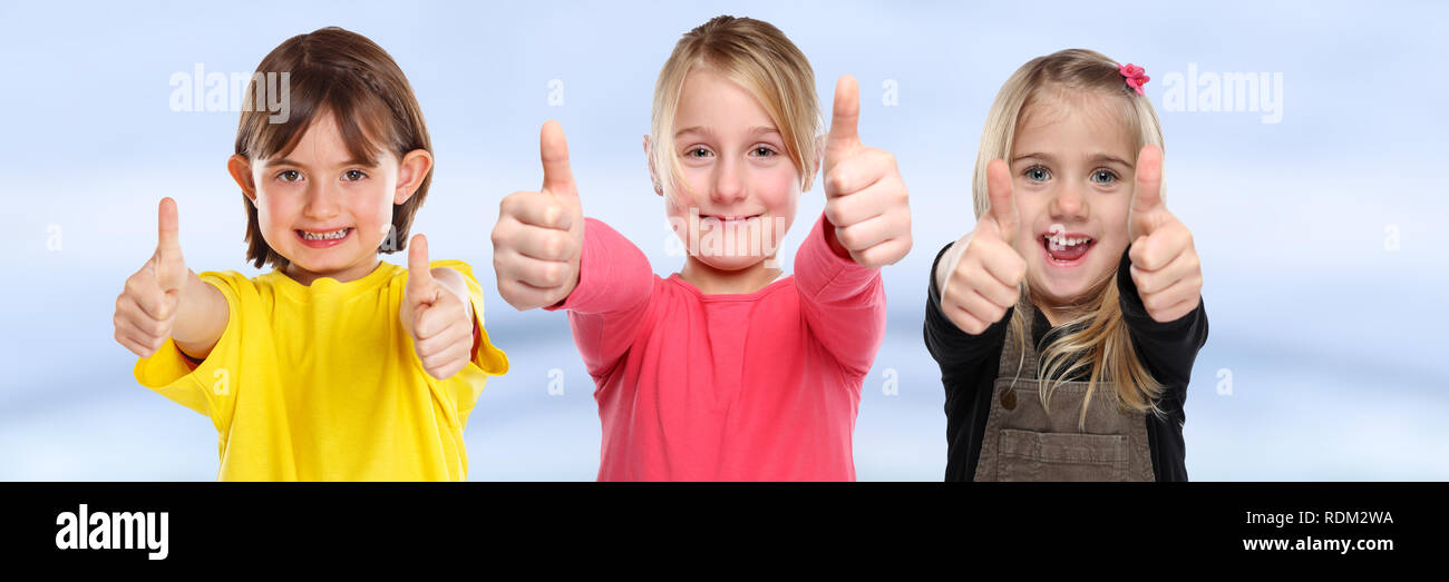 Group of children kids smiling young little girls success thumbs up positive young - Stock Image