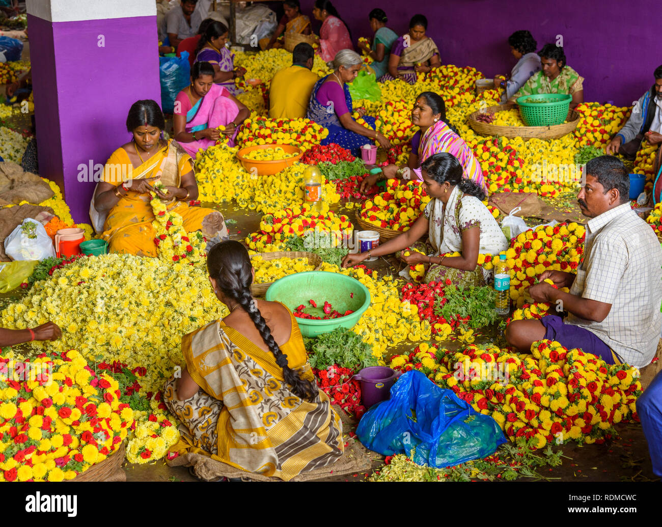 Women making flower garlands for sale, Krishnarajendra market, Banaglore, Bengaluru, Karnataka, India - Stock Image