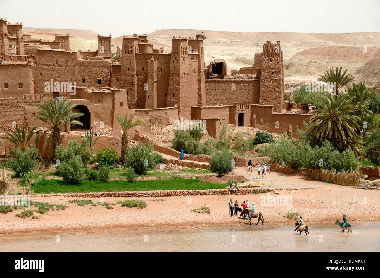 Tourists Visiting Ksar of Aït-Ben-Haddou aka Ait Benhaddou, an Adobe Earth Clay Built Fortified Village or Ighrem, and Popular Film Location Morocco - Stock Image