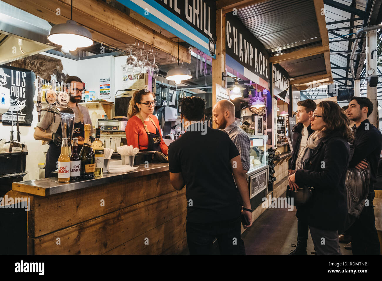 London, UK - January 13, 2019: People inside Mercato Metropolitano, the first sustainable community market in London focused on revitalising the area  - Stock Image