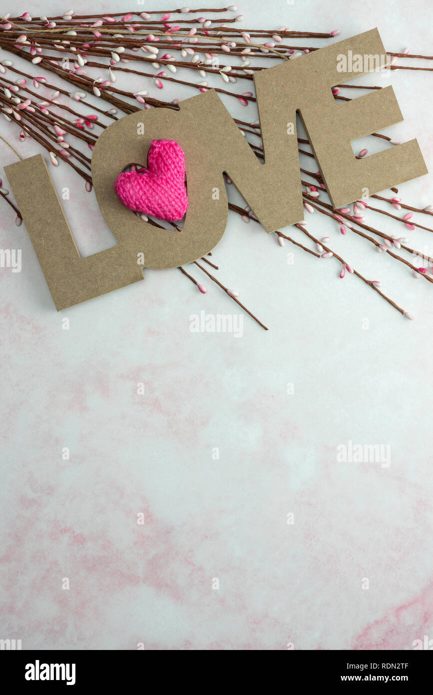 Love With Pink Knitted Heart And Spring Flower Buds On Pink Marble Background Stock Photo Alamy