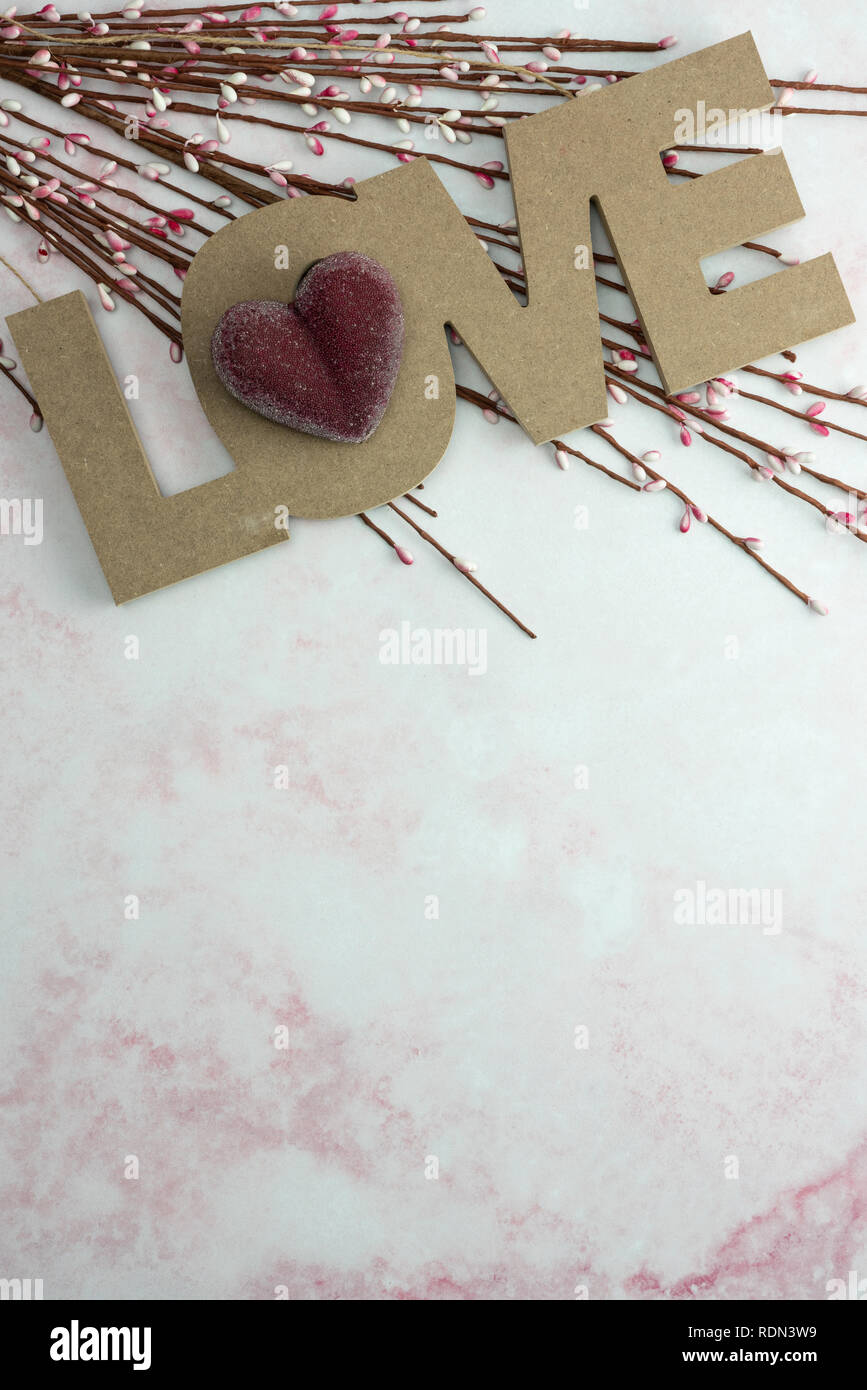 Red Heart On Word Love With Spring Flower Buds On Pink Marble Background With Copy Space Stock Photo Alamy