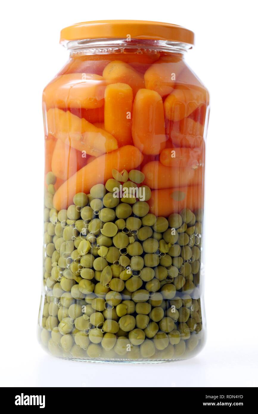 Peas and carrots conserved in glass packaging - Stock Image