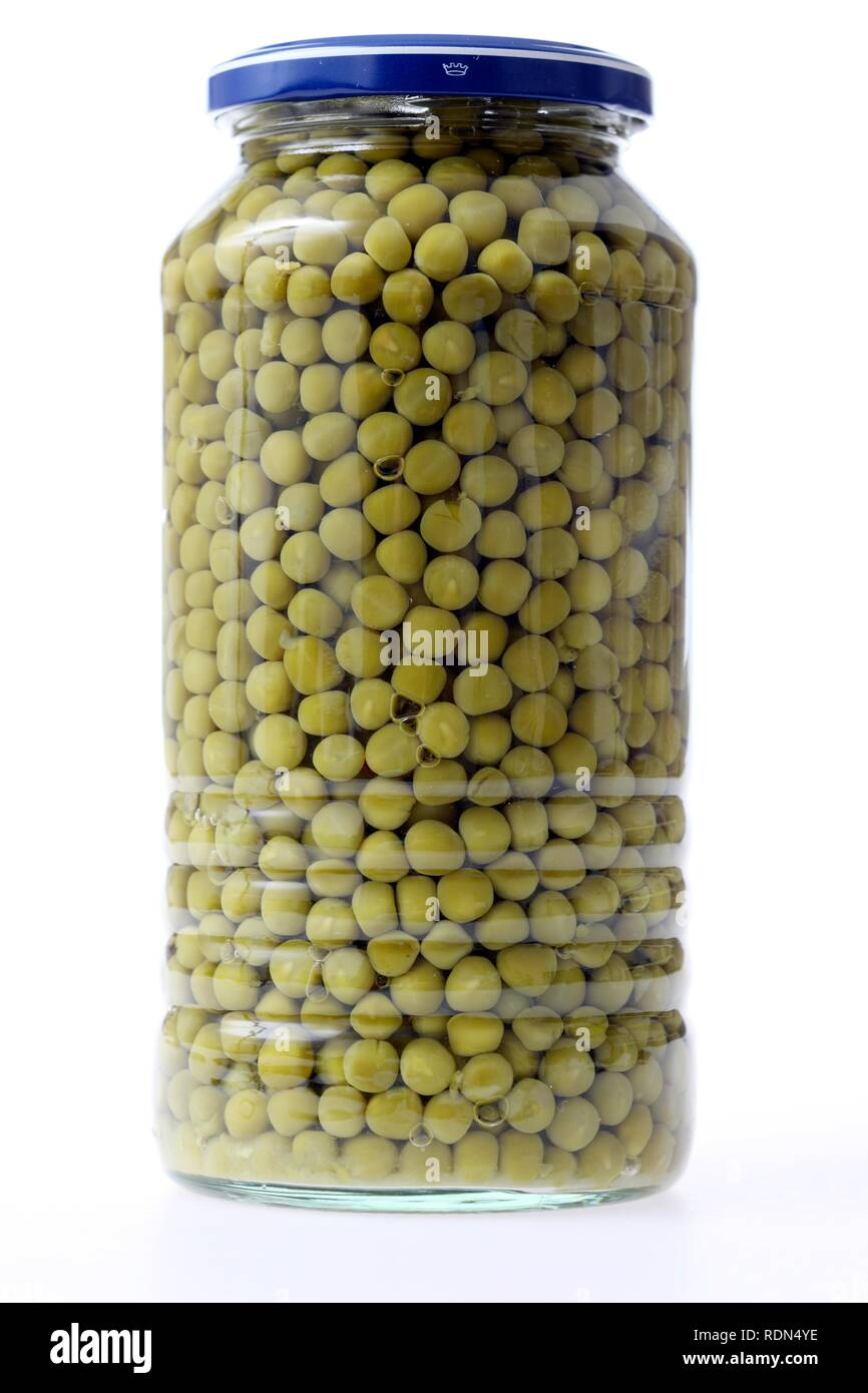 Peas conserved in glass packaging - Stock Image