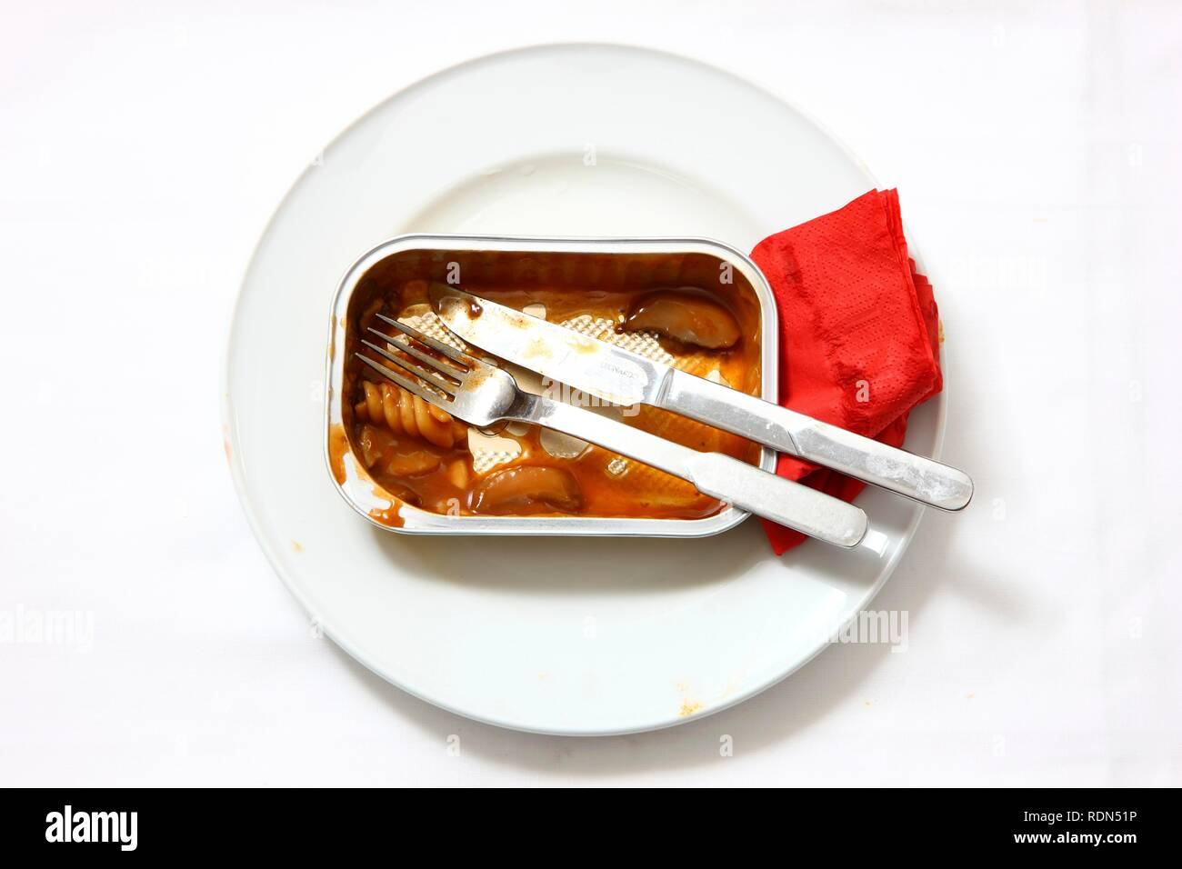 Remains of a pre-prepared meal after being eaten, served on a plate, in the original packaging Stock Photo