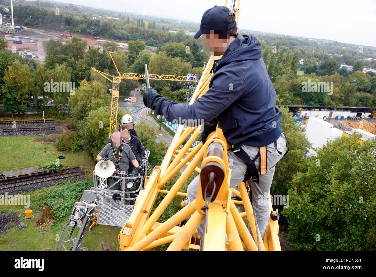 Special police unit negotiation group, operational rehearsal, a criminal has taken refuge on a construction crane and is - Stock Image