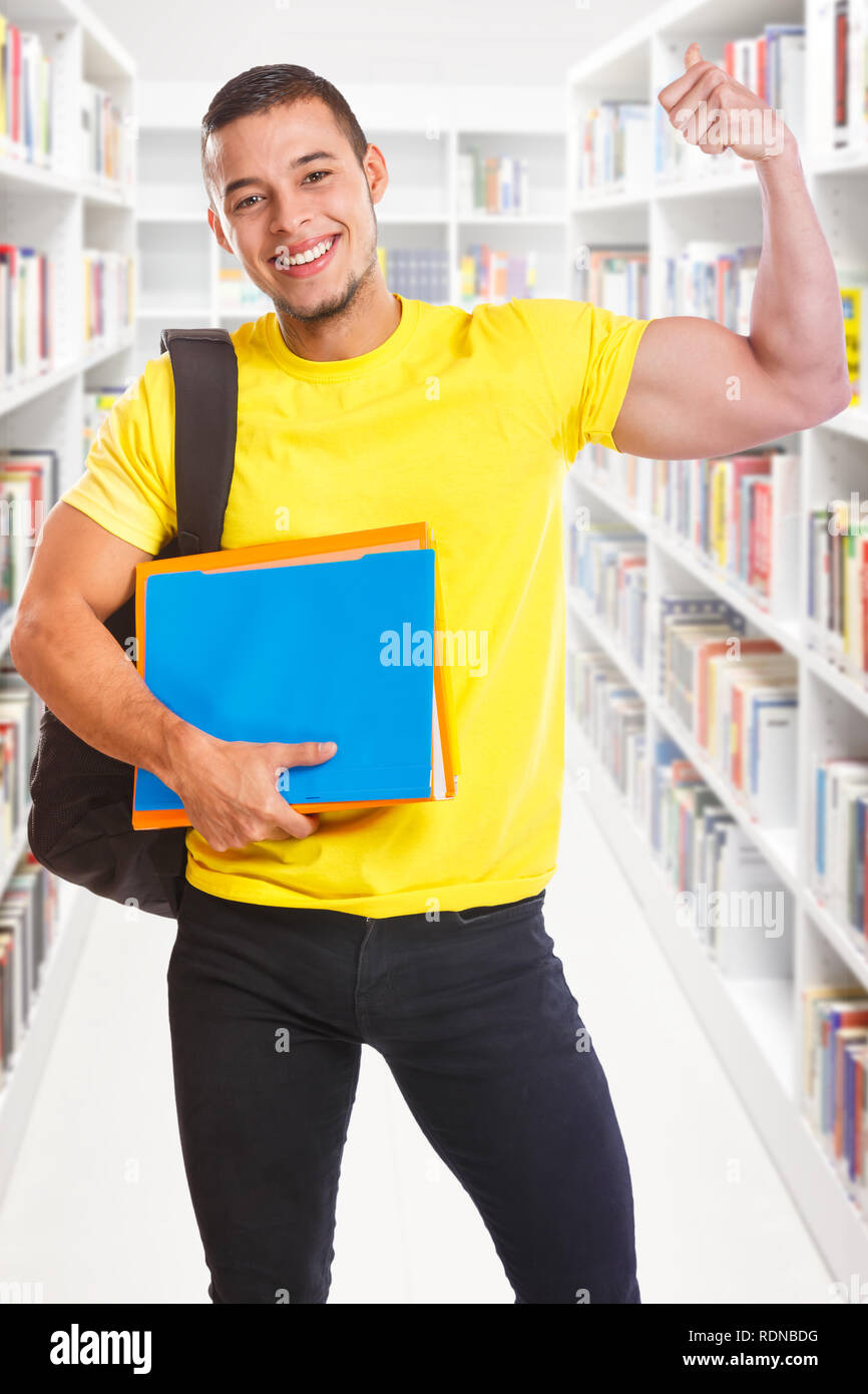 Student young man success successful portrait format strong power library education people learning - Stock Image