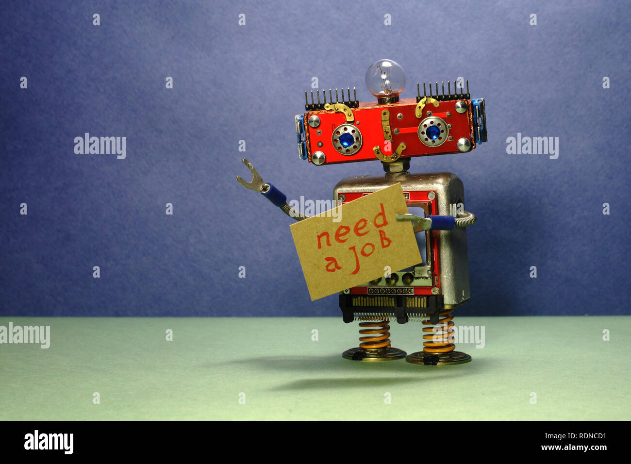 Job Search Advert Unemployed Red Robot Wants To Get A Job Funny Toy Robot With A Cardboard Sign And Handwritten Text Need A Job Blue Green Background Stock Photo Alamy