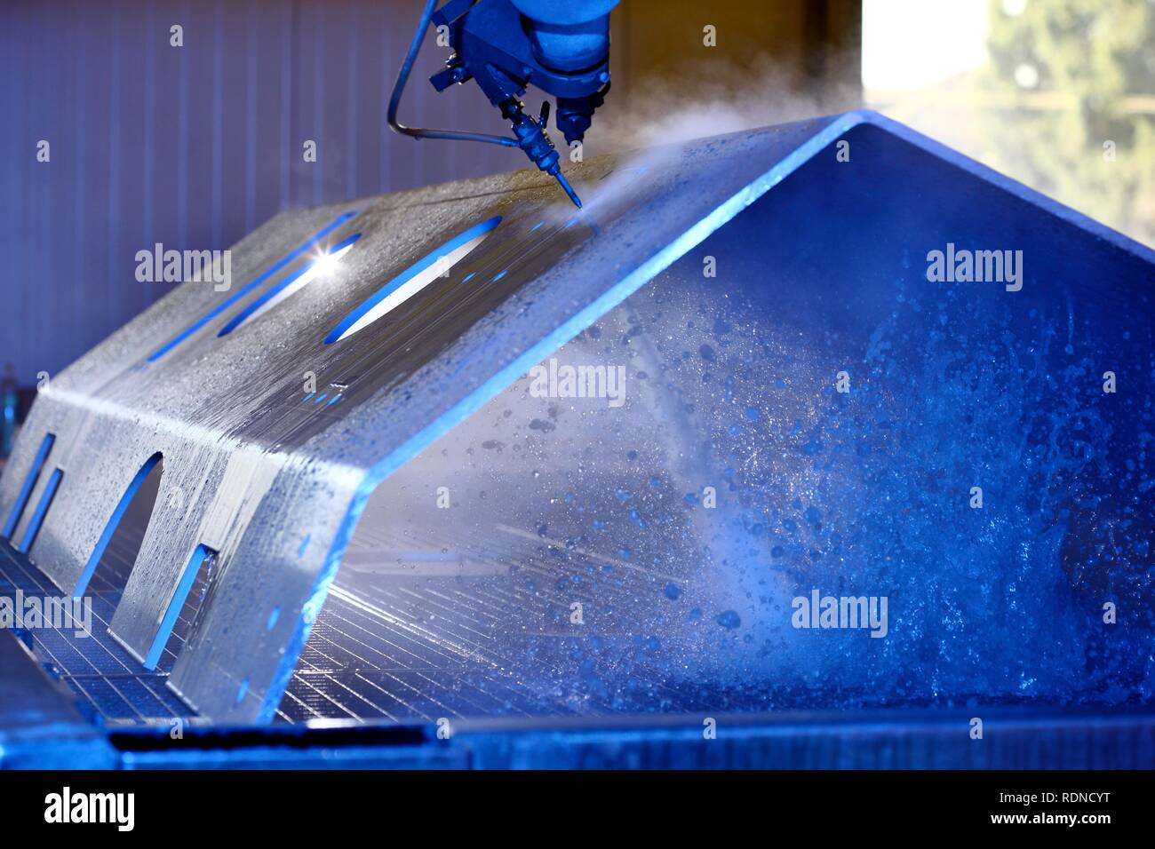 Water jet technology, precise technology for cutting metal with a high pressure water jet, where an abrasive material is added - Stock Image