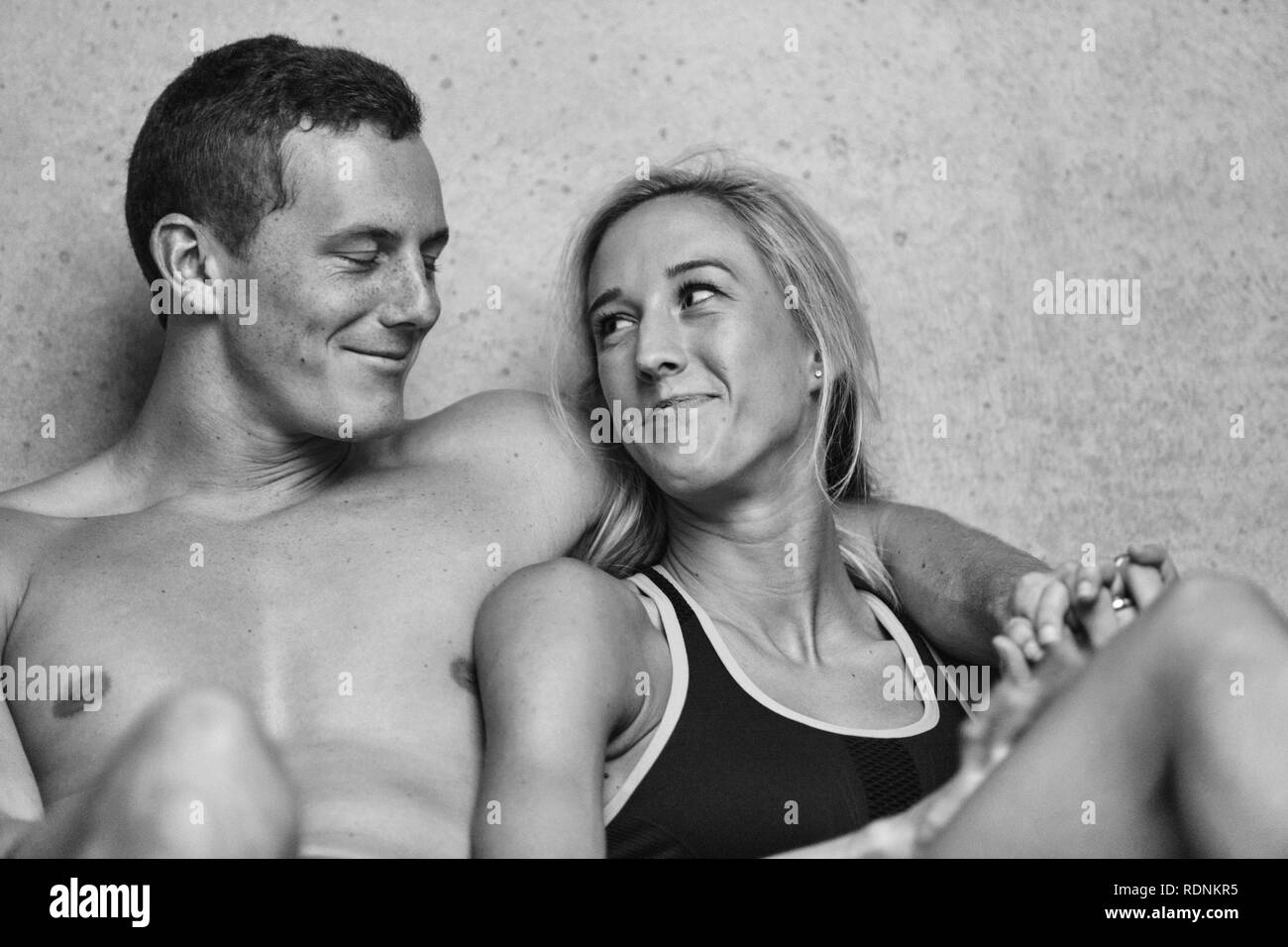 Fit young couple looking at each other - Stock Image
