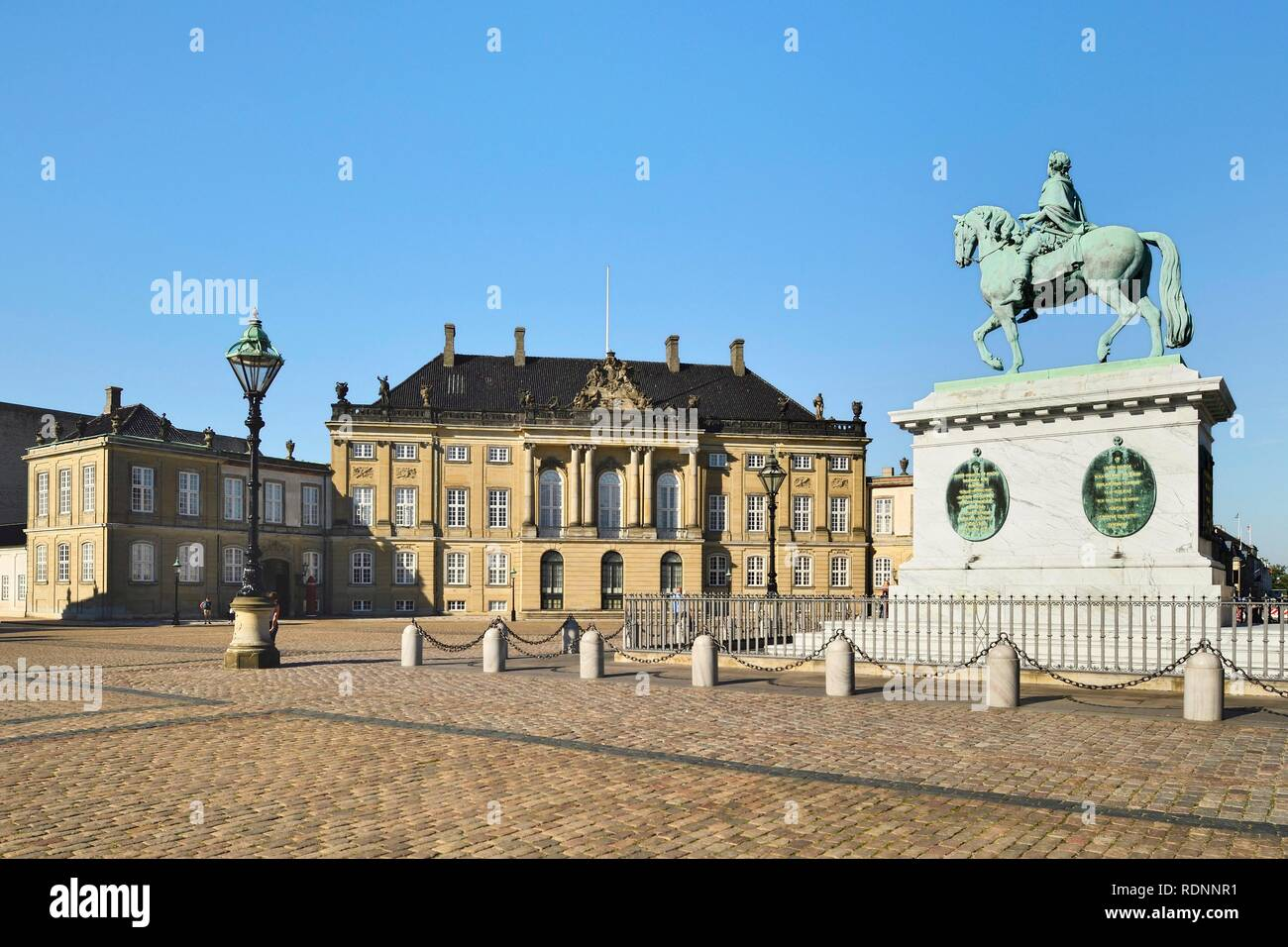 Frederik V's equestrian statue in front of Amalienborg Castle, Copenhagen, Denmark Stock Photo